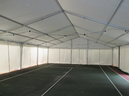 Image of clear span structure on 10 ft legs over tennis court