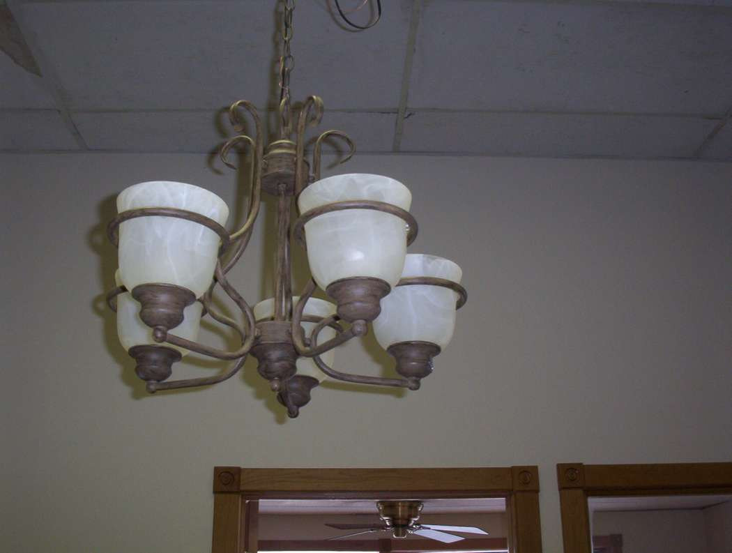 Image of clear span structure with 5 light bronze chandeliers