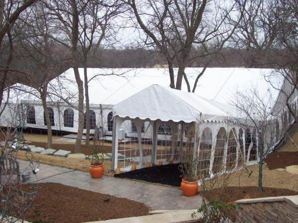 view of tent set for backyard wedding party with cathedral walls