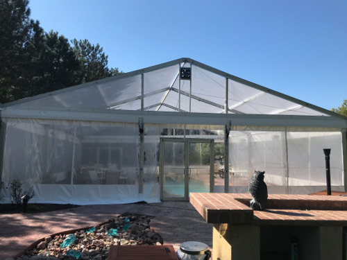 Image of clear tent set over pool