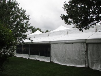 Image of high peak clear span tent with walls closed