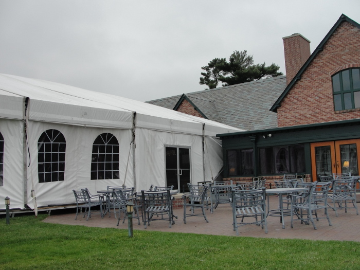 view of Omaha Tent Rental with cathedral walls and double doors at Omaha Country club