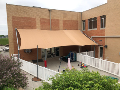 Shade cover provided for play area at YNCA.