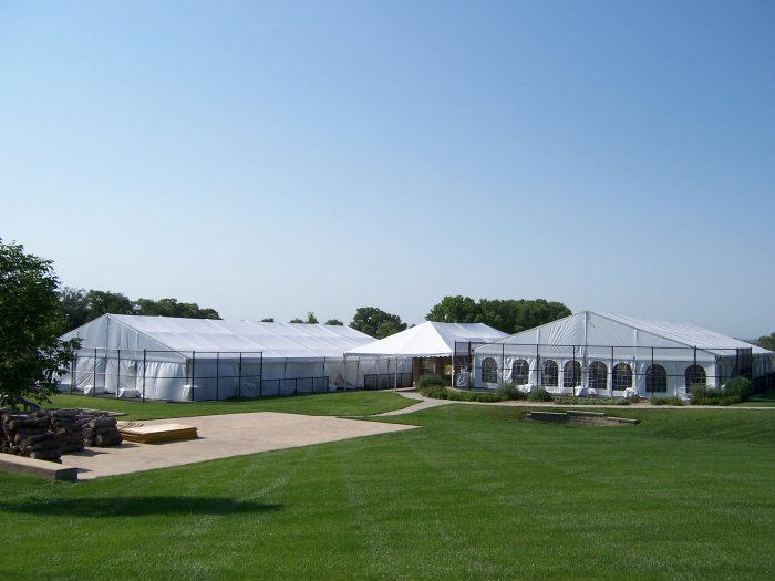 view of Tents set on tennis courts with cathedral walls