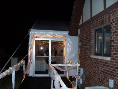 Night time view of Lincoln NE wedding tent with lighted entrance