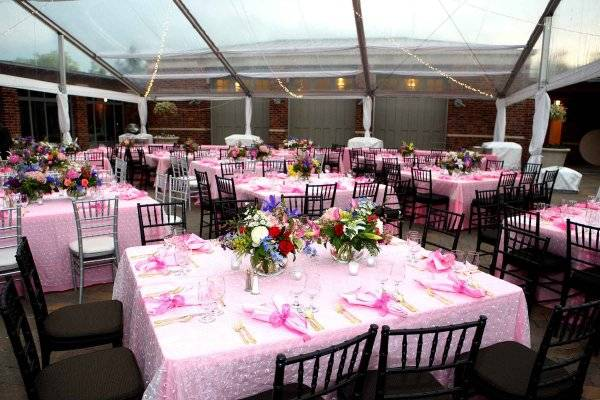 Image of tent set for a wedding reception. It is pretty and pink