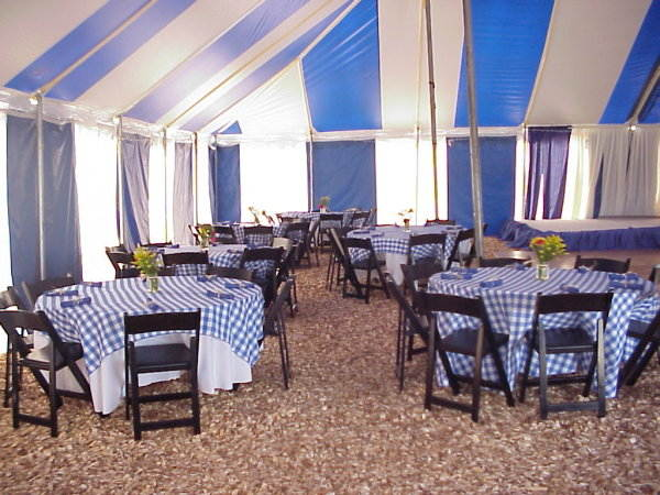 Image of interior of 60 X 60 tent decorated for a country style reception