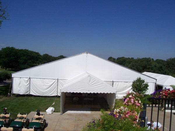 Image of large event tent at Ironwood country club with an entry tent