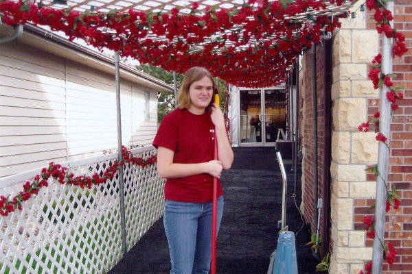 Image of enty way with rose garlands for party tent rental Lincoln, NE