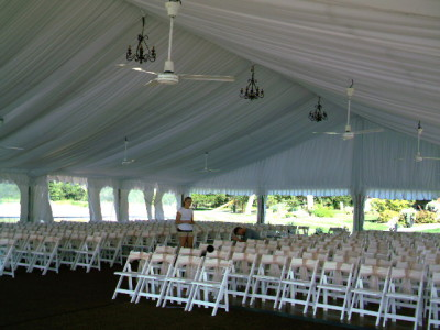 Image of chairs set inside tent for wedding ceremony