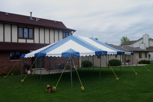 20 X 30 blue and white party tent set for a backyard graduation party