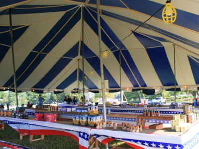 image of interior 60 X 60 blue and white tent used as a fireworks stand