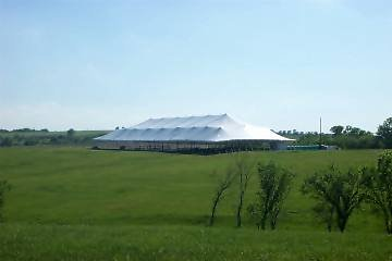 image of giant 86 X 215 white tent rental in a field