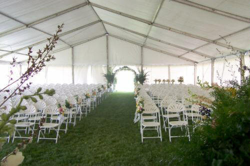 image of clearspan tent decorated without liner for a wedding ceremony with a spring like feel