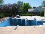 View of decking over a pool to create area to set tent in backyard