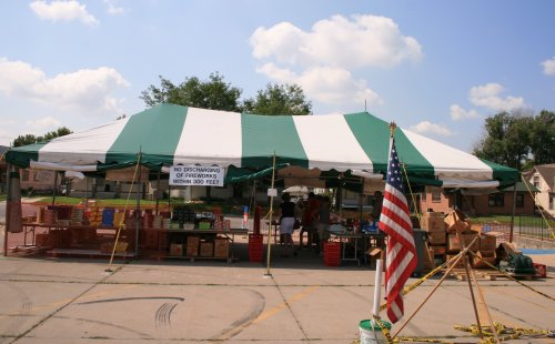 image of 20 X 40 green and white tent rental for small fireworks stand