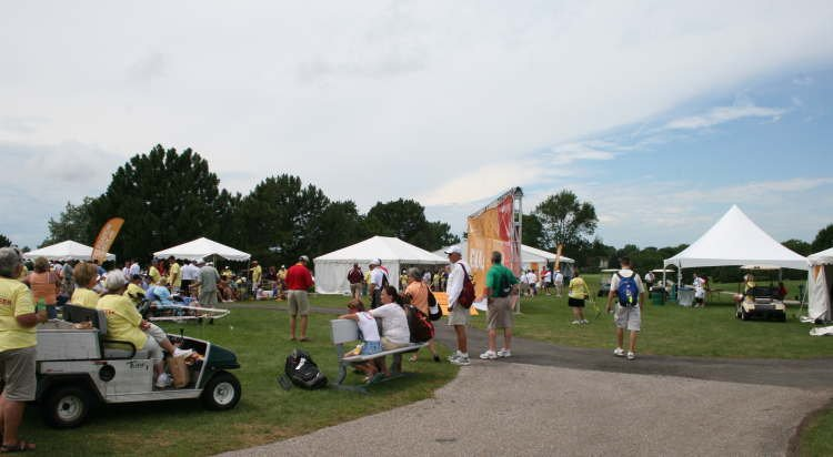 IMAGE of group of tents at golf tournament