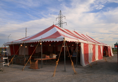 image of 30 X 70 red and white tent with walls on 3 sides