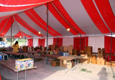 image of 30 X 70 red and white tent as a fireworks stand