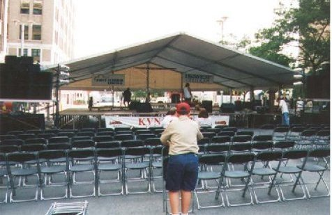 Image of an outdoor Concert tent used for a stage cover Lincoln, NE street festival