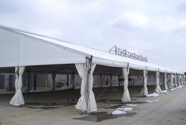 Image of a clear span tent used to create a permenant shade cover for a picnic area.
