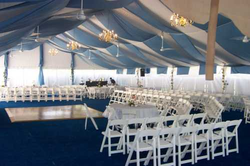 Omaha NE wedding tent rental decorated with blue bunting