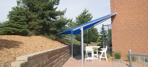 Image of a triangular shade cover for ticket takers at pool.