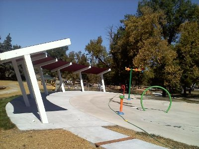 Image of shade structures set in a semi circle for water play area.