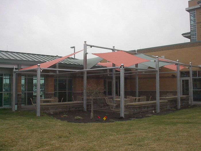 Image of shade structure over hospital outdoor eating area.
