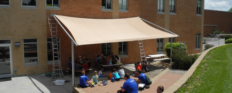 Image of custom made shade structure for YMCA patio area Lincoln, NE.