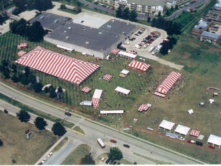 Image of tents set for an outdoor show