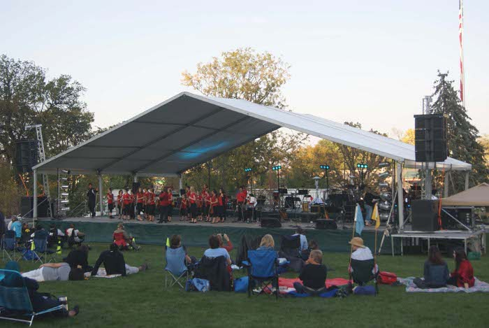 Temporary outdoor stage in park for Omaha, NE summer music series