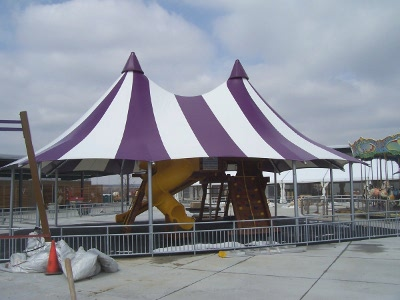 Image of double peak shade structure, to provide shade cover for the playgoround area.