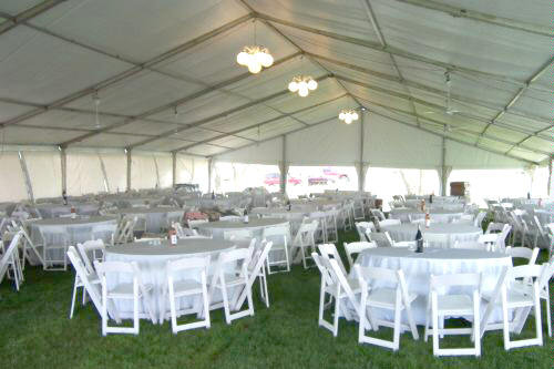 Clear span tent inside view of tent set for dinner party