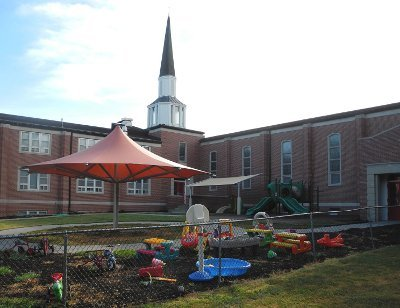 Image of an umbrella style playground shade cover at church daycare.
