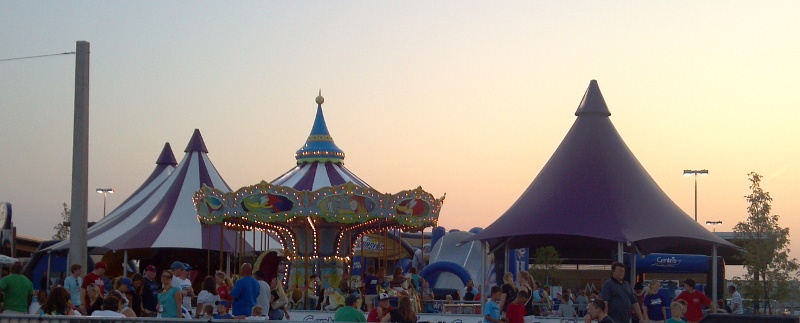 Image of double peak shade structure with nearby merry go round top and single peak shade structure.