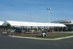 Entryway awning rental to auto showroom