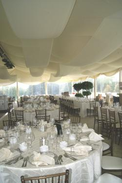 Image of liner with customer supplied festooning in wedding tent Omaha, Nebraska