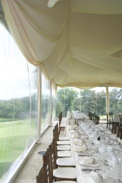Image of clear walls on wedding reception tent Omaha Ne