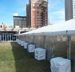 Kansas City huge tent with doubled stacked weights along side of tent