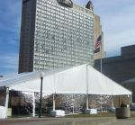 Kansas City tent rental with single stacked weights along front of tent