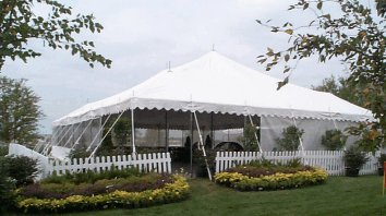 Image of decorated white festival wedding tent, sometimes called a canopy