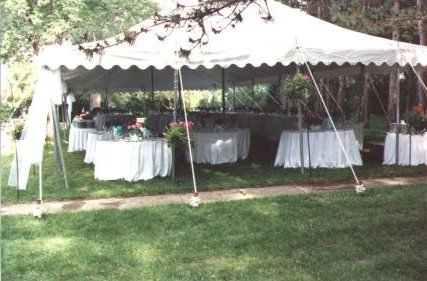 30 X 70 white party tent rental Lincoln, NE with round tables and white table cloths